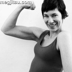 Bicep flexing woman