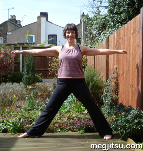 Meg doing yoga pose in garden