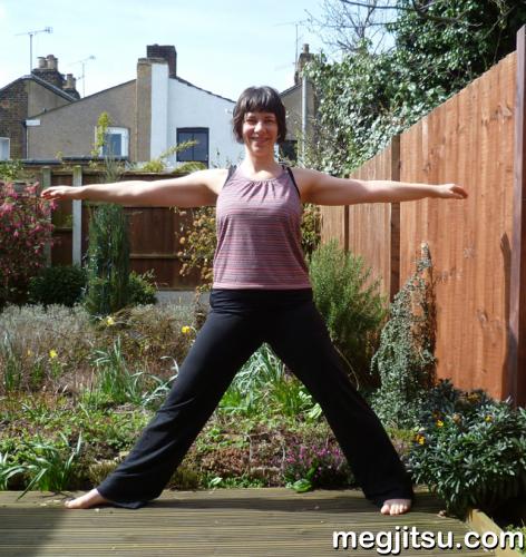 Meg doing yoga pose in garden